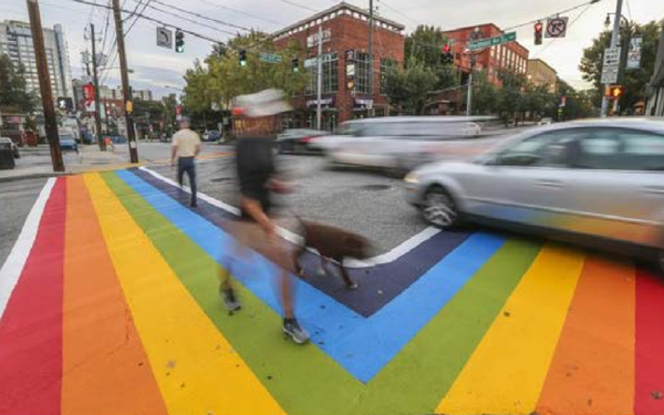 BiennialReport- AJC Image of 10th & Piedmont Ave Rainbow Crosswalk.png